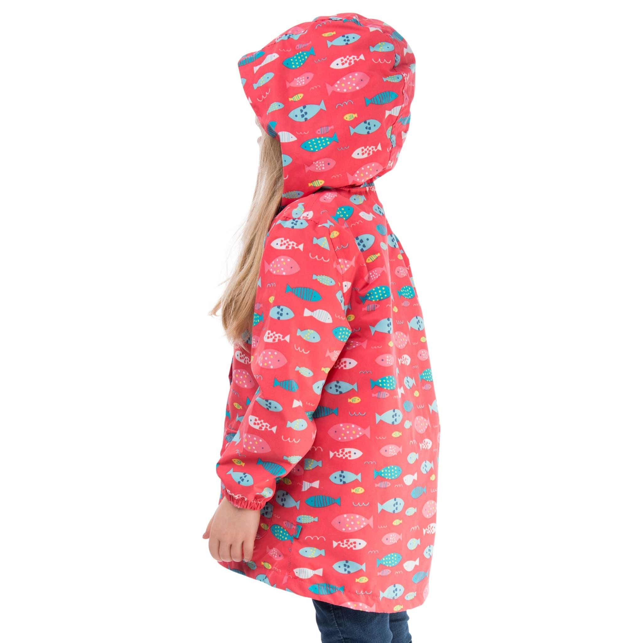 Carrie Girls Waterproof Hooded Jacket, in Rose Pink Fish Print, Modelled Side View | Lighthouse
