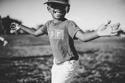 black boy smiling and running
