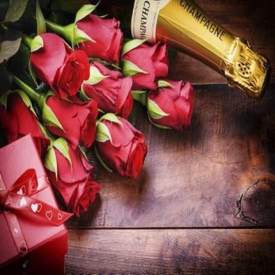 Twelve Luxury Red Roses, Champagne & Chocolates.