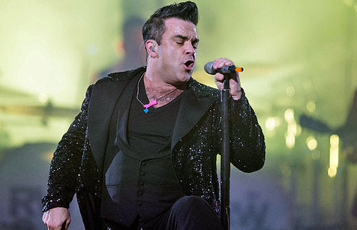 Robbie Williams hits the stage in a Name Necklace