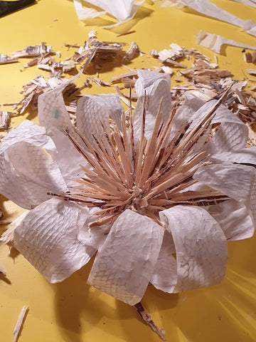 plywood and papier mache flower