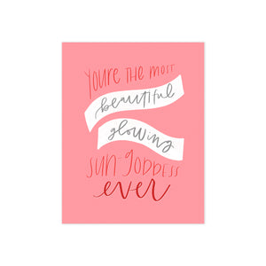 oh joyful day greeting card dark pink background with hand lettering of you're the most beautiful, glowing sun-goddess ever in red lettering with with banners