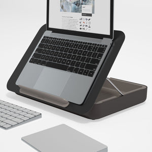 The Black Bento Toolbox as a laptop stand in white space with a laptop or macbook on top