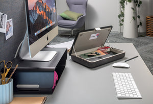 Desk with open Bento toolbox and adjustable riser on it