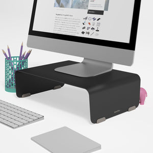 The Black Bento fixed monitor stand with a laptop or monitor on top in white space