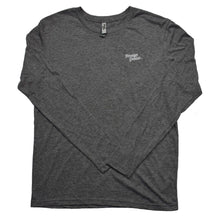 picture of the front of a vintage grey long sleeve t shirt with small foreign genius logo on the front right of the shirt