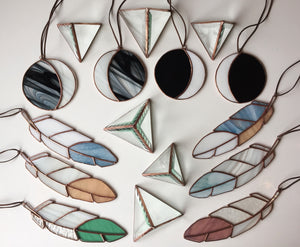 stained glass moon feathers pyramid