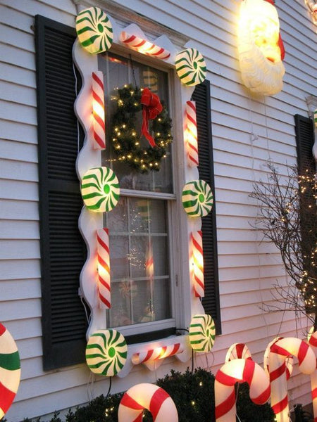 christmas window decorated with candy lights