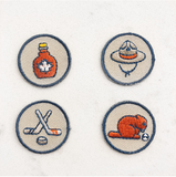 Canadian emblem iron-on patches. Contains a Maple syrup patch, mountie patch, beaver patch, and a hockey sticks patch,