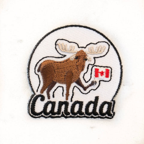 Iron on patch with Canadian moose holding a Canadian flag