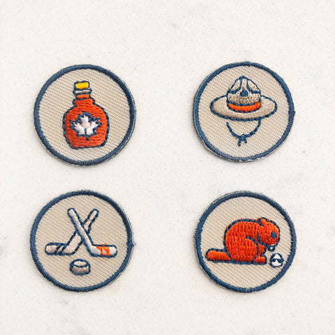 Canada iron on patches that look like scouts of canada badges or girl guides badges