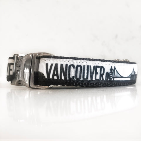 The vancouver dog collar from Bone and Bred seen here in black and white with a silver buckle.