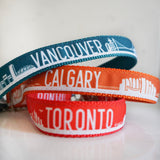 A pile of dog collars displaying the Vancouver collar, Calgary collar and Toronto collar from Bone and Bred