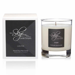 Juniper scented white candle in large glass tumbler