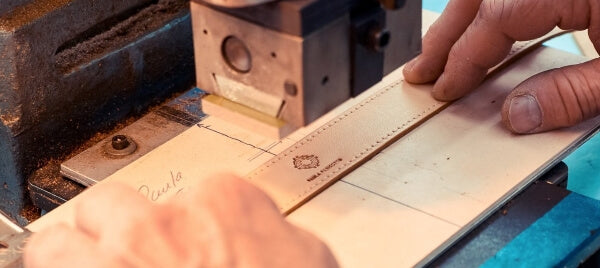 Leather craftsmen working on cork belt designed by Paula Parisotto.