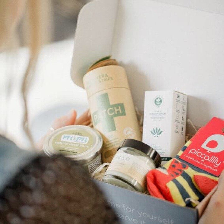 A shot to show the size of an ecocobox and the full size products it typically contains. This box contained 5 full size items from natural and ethical brands chosen to compliment mum whether she is pregnant or has a new baby.