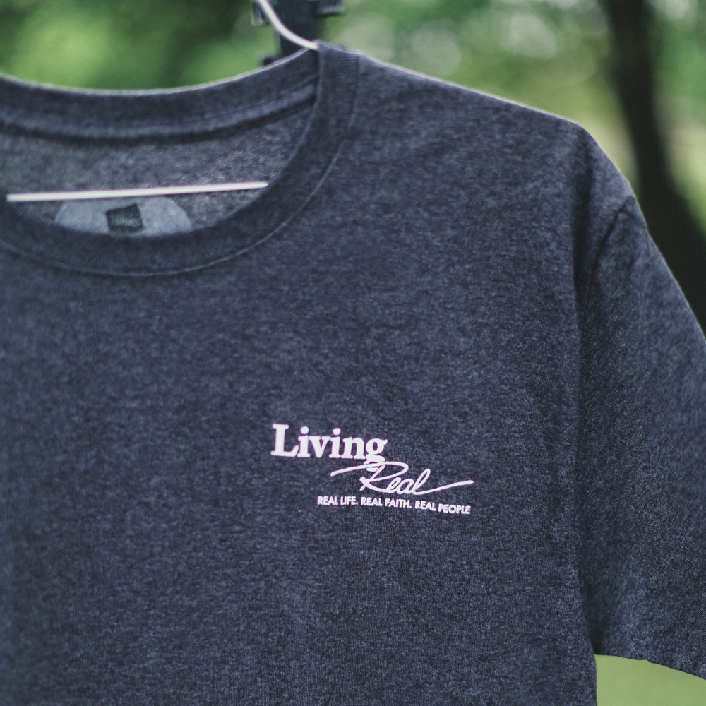 Retired Logo Charcoal Tee with Living Real Quote