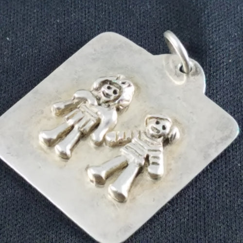Cute boy and girl friends pendant