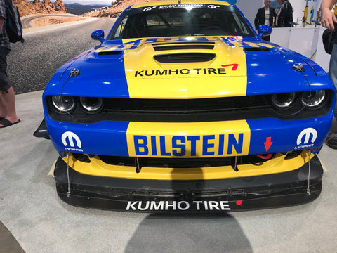 yellow and blue dodge charger with bilstein logo