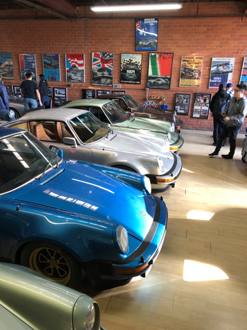 row of magnus walker cars in his garage