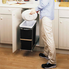 30L under counter pull-out can - lifestyle man scraping plate