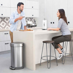 45L semi-round step can with liner rim - brushed finish - lifestyle man and woman in kitchen