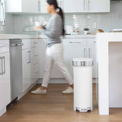 45L slim step can - white steel - lifestyle woman in background in kitchen
