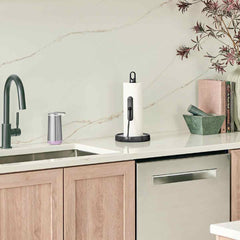 tension arm paper towel holder - black finish - lifestyle next to kitchen sink