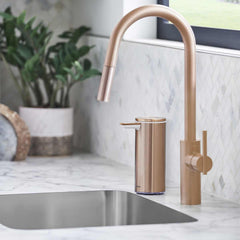 rechargeable liquid soap sensor pump - rose gold finish - lifestyle in bathroom