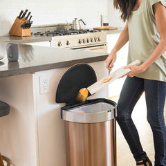 45L semi-round sensor can - rose gold finish - lifestyle scraping food into trash can in kitchen