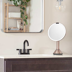 sensor mirror with touch-control brightness and dual light setting - rose gold finish - lifestyle in bathroom image