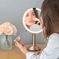 sensor mirror trio - rose gold finish - lifestyle woman applying makeup
