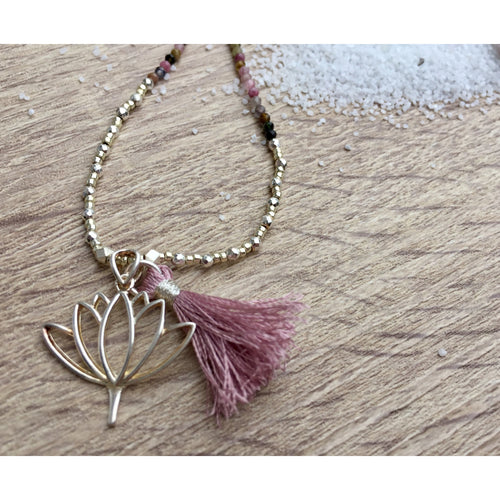 This necklace has a bohemian flair with a beautiful lotus flower