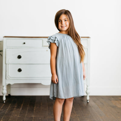Baby Girl Clothes: girl standing in ruffle dress