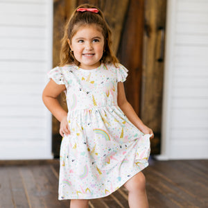 Baby Girl Clothes: model popping her leg in dress