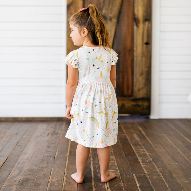 Baby Girl Clothes: girl standing in unicorn white dress