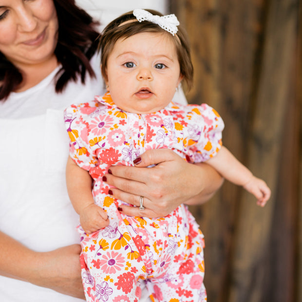 Baby Girl Clothes: mom holding baby on hip