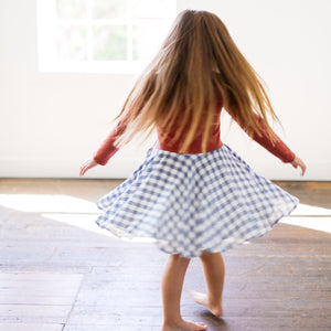 Baby Girl Clothes: girl twirling in plaid and rust dress