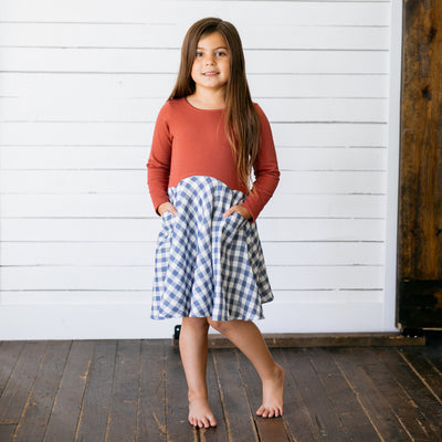 Baby Girl Clothes: model with hands in her dress pockets