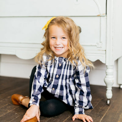 Baby Girl Clothes: girl sitting by dresser