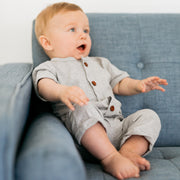 Baby Girl Clothes: boy leaning up against blue couch