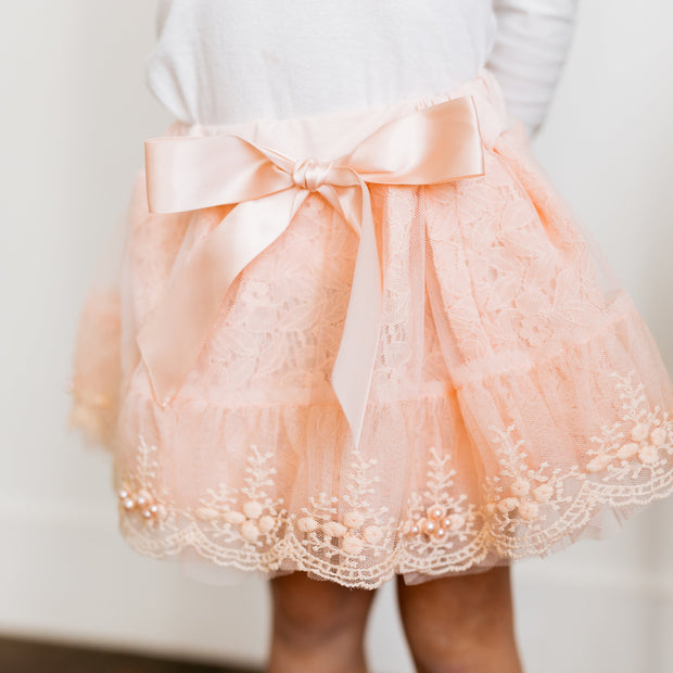 Baby Girl Clothes: zoom on pink bow on skirt