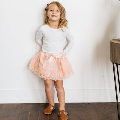 Baby Girl Clothes: pink skirt and white shirt on girl