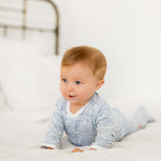 Baby Girl Clothes: boy pushing up on bed