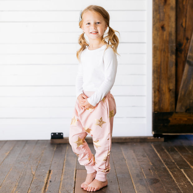 Baby Girl Clothes: pink and gold joggers on girl