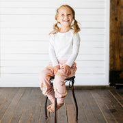 Baby Girl Clothes: girl sitting on chair