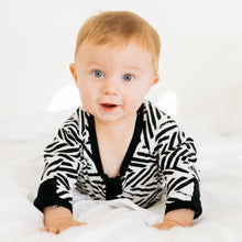 Baby Girl Clothes: baby pushing himself up on bed