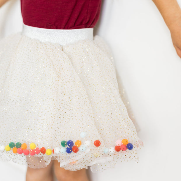 Baby Girl Clothes: close view of pom poms in skirt