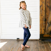 Baby Girl Clothes: model standing by barn door