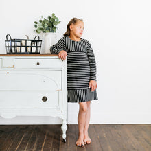 Baby Girl Clothes: leaning up on white barn dresser